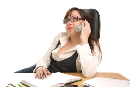Beautiful businesswoman calling by phone at office photo