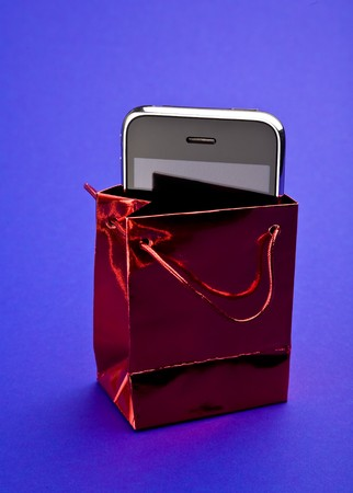 Phone in red gift packet photo