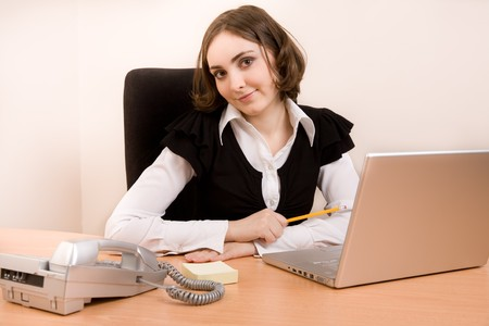 appointee: Young businesswoman working at the office and looking to the camera