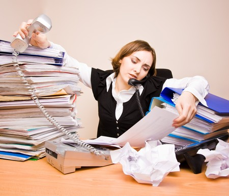 tons: Young businesswoman with tons of documents calling phone Stock Photo