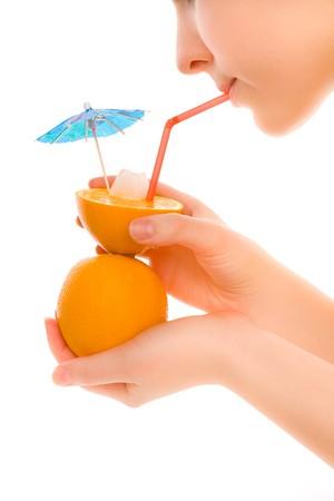 Woman drinking creativity  orange juice isolated on white background photo