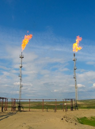 Two burning oil gas flares photo