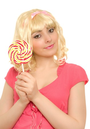 Beautiful woman in blond wig with lollipop isolated on white photo