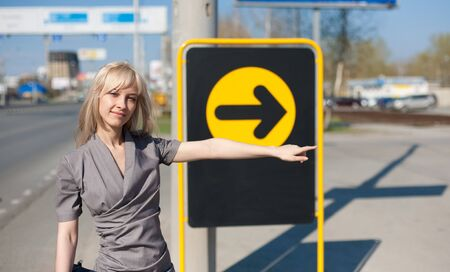 Woman showing a direction outdoors Stock Photo - 7873105