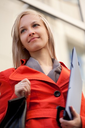 Businesswoman with blue folder outdoors photo