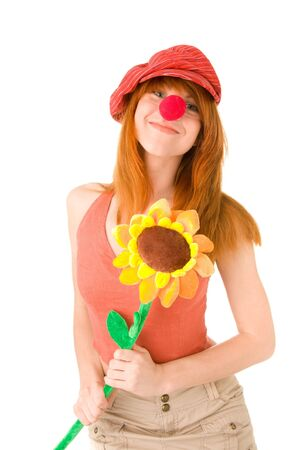 Smiling clown girl with flower photo