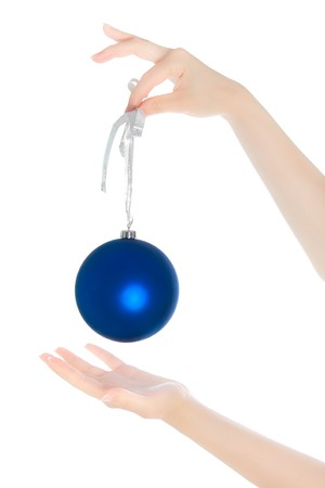 woman hanging toy: Womans hands with new year toy isolated on white