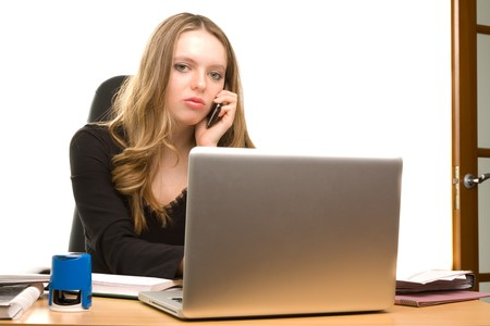appointee: Young businesswoman talking to phone at the office