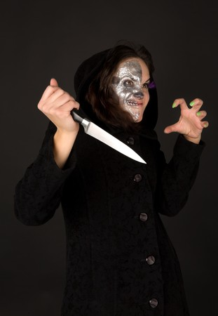 Two-faced witch with knife crinkled photo