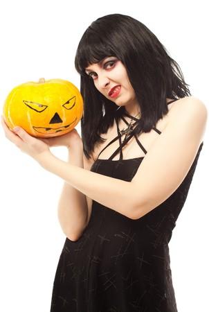 Strange woman in black dress holding a Jack-o-lantern photo