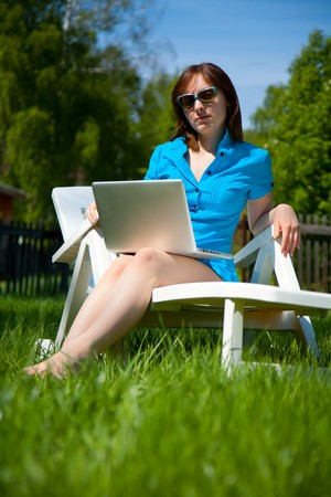 Picture of businesswoman with laptop  outdoors photo