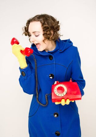 Girl with old red telephone screaming Stock Photo - 8054654