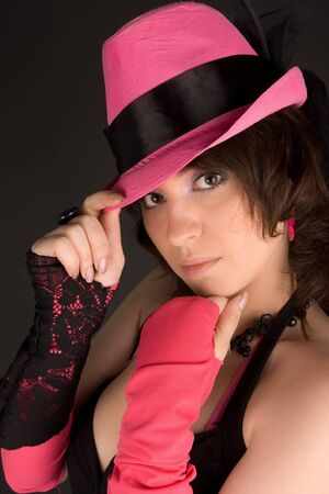 Woman in black dress with pink hat posing Stock Photo - 8054782