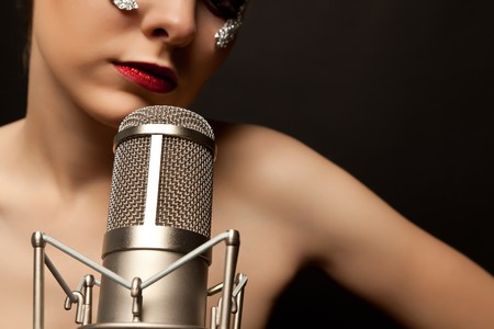 Young gothic singer standing with microphone naked photo