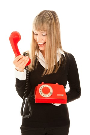 Smiling woman with old telephone photo