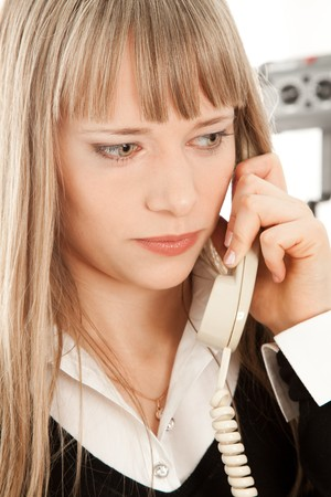 Beautiful businesswoman calling by phone and thinking photo