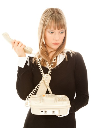 Blond beautiful businesswoman holding  phone and looking sadness photo