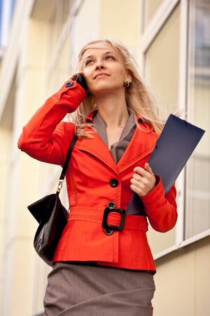 Beautiful blond businesswoman on the phone photo