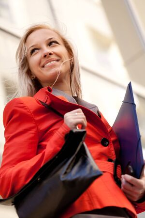 Young blond busnesswoman smiling photo