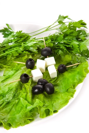 Canape, onion  and lettuce on the white plate photo