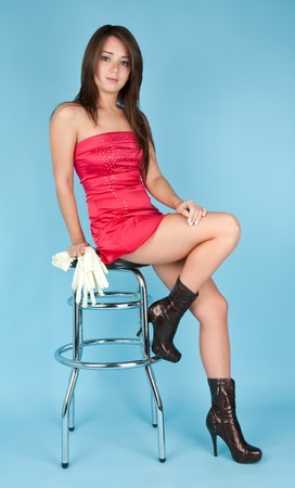 Beautiful girl sitting on the barchair with white gloves photo