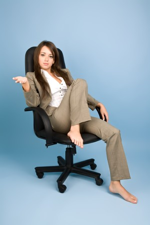 Woman in costume sitting in office chair photo