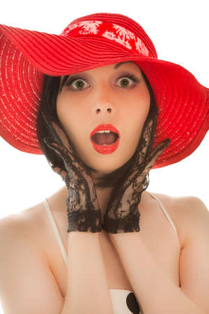 Retro-styled woman in red hat surprised isolated on white background Stock Photo - 8054771