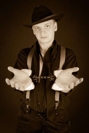 Old-styled photo of gangster in handcuffs Stock Photo - 8305232