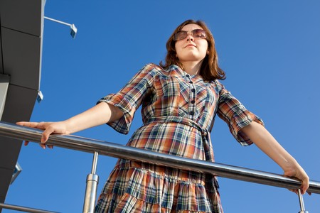 Woman in checkered dress in the sun Stock Photo - 8305235