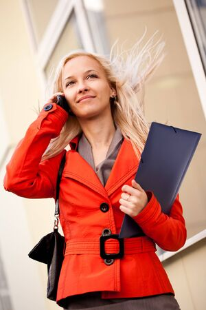 Businesswoman on the phone outdoors photo