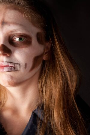 Woman with halloween make up looking to the camera photo