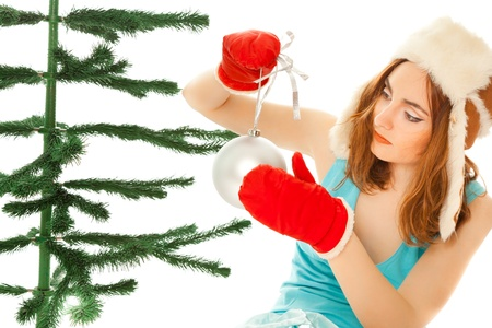Woman's hands dressing christmas tree Stock Photo - 8481763