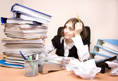 Young businesswoman with tons of documents thinking Stock Photo - 8481715