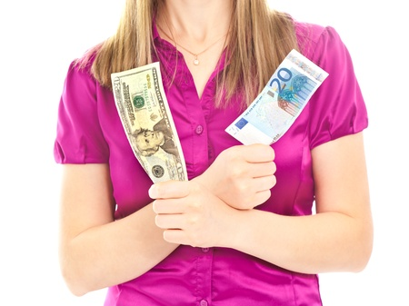 Woman holding two different banknotes Stock Photo - 8481734