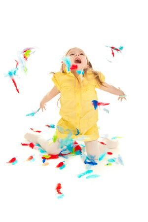 Little girl playing with colorful feathers isolated Stock Photo - 8603315