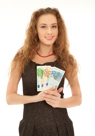 Woman with banknotes smiling isolated on white photo