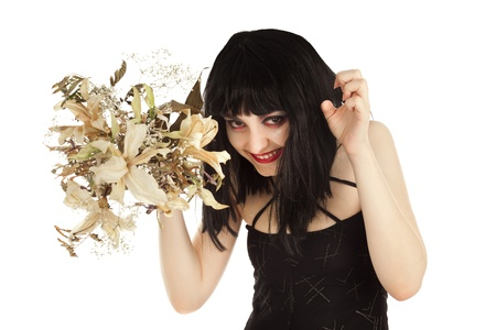 crafty: Witch with bunch of dry flowers looking crafty isolated on white