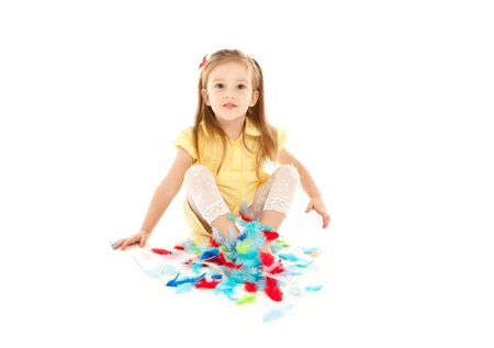 Little girl playing with colorful feathers isolated photo
