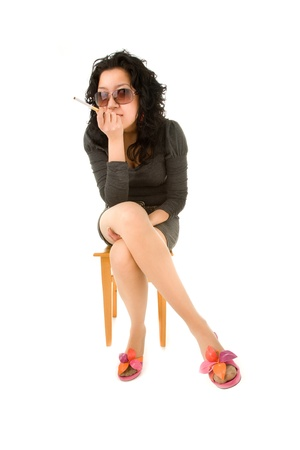 Woman sitting on the chair and smoking photo