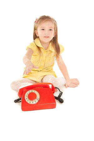 Little girl with old red phone sitting on the floor Stock Photo - 8893246