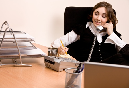 appointee: Picture of businesswoman calling by phone at office