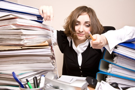 appointee: Tired businesswoman with a lot of folders and telephones