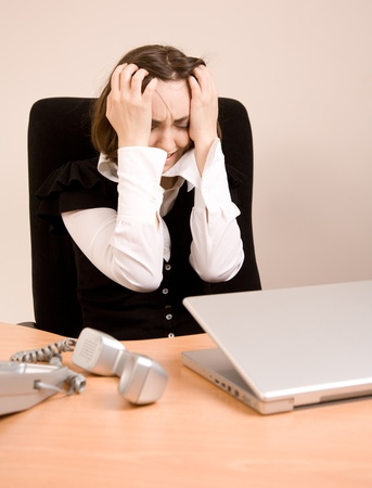 appointee: Young businesswoman  sitting at the office screaming