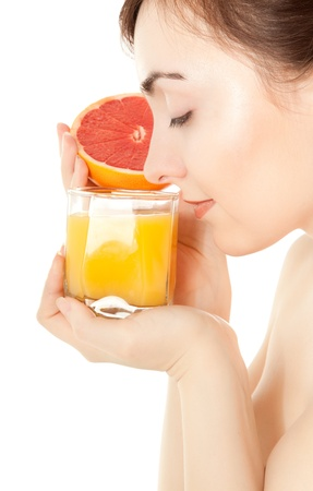drinking juice: Woman with a glass of fresh juice isolated on white Stock Photo