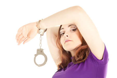 Woman with handcuffs isolated on white Stock Photo - 9317654
