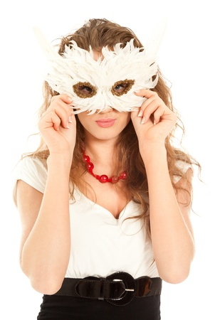 Beautiful woman in dress holding a mask and looking to the camera isolated photo