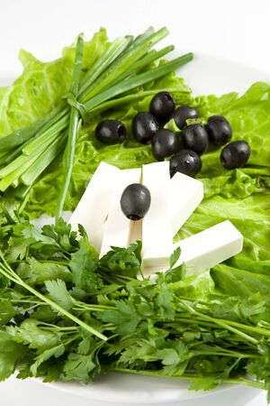 Feta cheese with black olives, lettuce and onion photo