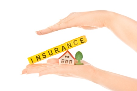 Woman's hands holding house and word insurance Stock Photo - 9738954