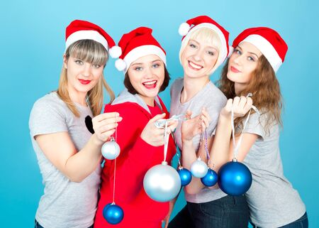 Four happy women with new year balls smiling photo