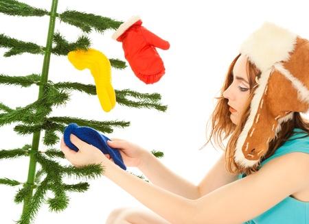 Woman dressing christmas tree Stock Photo - 9962392